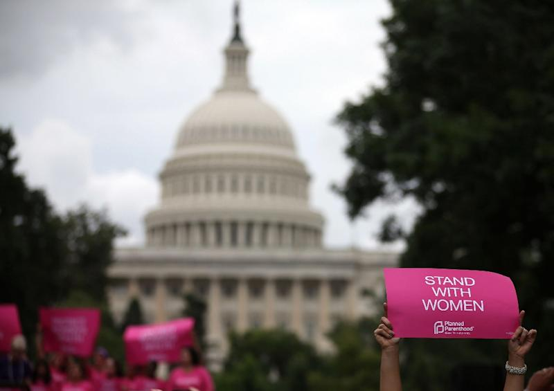 Women hold up signs during a pro-choice rally hosted by Planned Parenthood on July 11, 2013 in Washington, DC (AFP Photo/Mark Wilson)