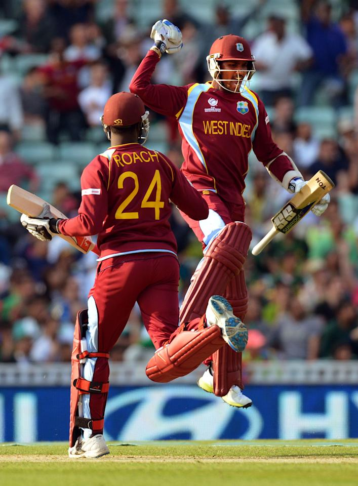 West Indies' Kemar Roach (left) and Denesh Ramdin (right) celebrate their victory during the ICC Champions Trophy match at The Oval, London.