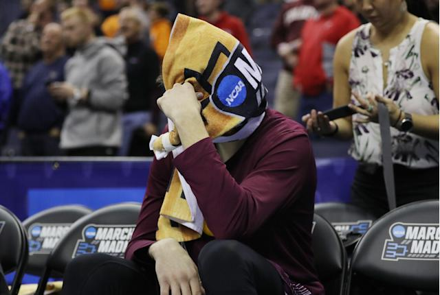 Rapolas Ivanauskas spent part of Friday's game with a towel wrapped around his head on the bench. (Getty)