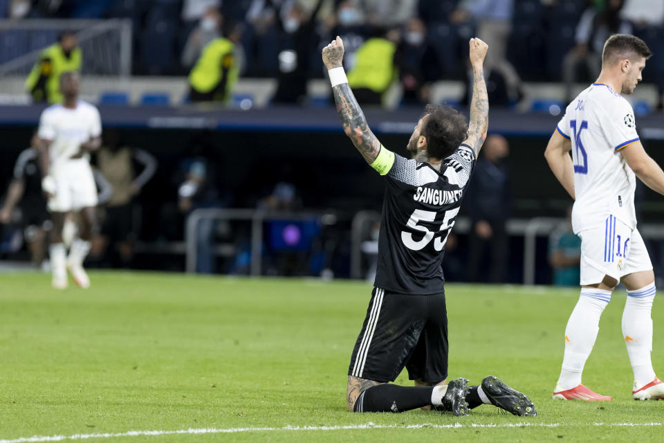 MADRID, SPAIN - SEPTEMBER 28: (BILD OUT) Gustavo Dulanto ofFC Sheriff Tiraspol celebrate after winning during the UEFA Champions League group D match between Real Madrid and FC Sheriff at Estadio Santiago Bernabeu on September 28, 2021 in Madrid, Spain. (Photo by Berengui/DeFodi Images via Getty Images)