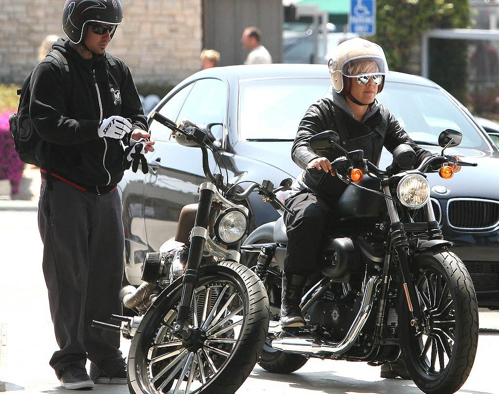 """Pink and husband Carey Hart took a break from baby Willow to ride their Harley Davidsons up the Pacific Coast Highway in Malibu on Saturday. We're sure they're the coolest mom and dad on the block! <a href=""""http://www.infdaily.com"""" target=""""new"""">INFDaily.com</a> - July 23, 2011"""