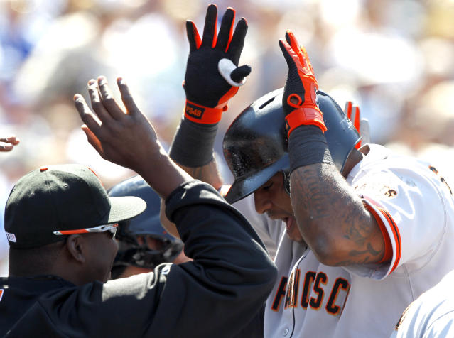 San Francisco Giants' Pablo Sandoval, right, shouts as he celebrates with teammates after hitting three-run home run against the Los Angeles Dodgers in the fifth inning of a baseball game on Saturday, April 5, 2014, in Los Angeles. (AP Photo/Alex Gallardo)