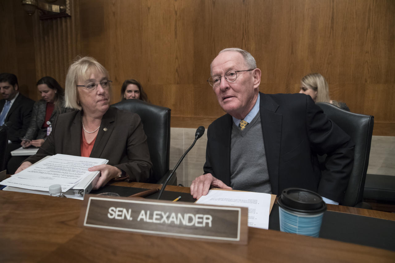 Sen. Patty Murray, D-Wash., the ranking member, and Sen. Lamar Alexander, R-Tenn., chairman of the Senate Health, Education, Labor, and Pensions Committee, meet before the start of a hearing on Capitol Hill in Washington, Wednesday, Oct. 18, 2017, the morning after they reached a deal to resume federal payments to health insurers that President Donald Trump had halted. (AP Photo/J. Scott Applewhite)