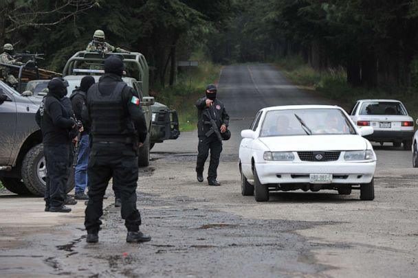 PHOTO: Police and military personnel stop a vehicle as they search for a French and a Mexican citizen who were kidnapped in Texcaltitlan, southwest Toluca, central Mexico, on Nov. 25, 2019. (AFP via Getty Images, FILE)