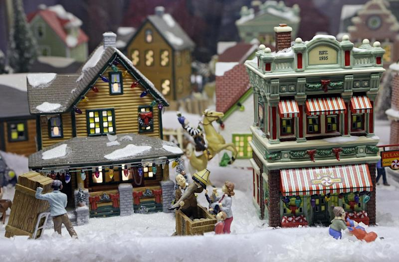 "In this Nov. 21, 2013, photo, a miniature street scene from the movie ""A Christmas Story"" is displayed in the Christmas Story museum in Cleveland. The 30th anniversary of the quirky holiday film turned classic is celebrated in the city where Ralphie's house was restored and turned into a museum. (AP Photo/Mark Duncan)"