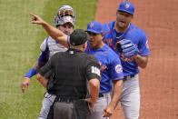 New York Mets manager Luis Rojas, center, makes his point to umpire Jeremy Riggs (112) with catcher Tomas Nido, left rear, and starting pitcher Taijuan Walker, right rear, looking on during the first inning of a baseball game against the Pittsburgh Pirates in Pittsburgh, Sunday, July 18, 2021. Rojas was ejected from the game. (AP Photo/Gene J. Puskar)
