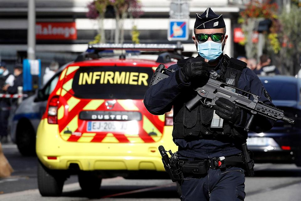 Image: A security officer guards the area after a reported knife attack at Notre Dame church in Nice, France (Eric Gaillard / Reuters)