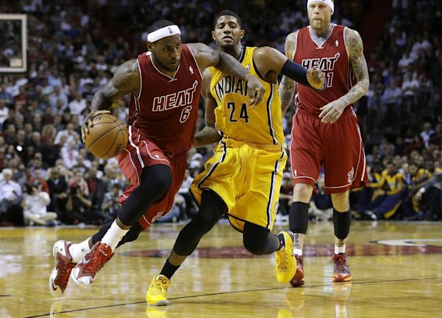 Miami Heat's LeBron James (6) drives to the basket past Indiana Pacers' Paul George (24) during the second half of an NBA basketball game, Wednesday, Dec. 18, 2013, in Miami. The Heat defeated the Pacers 97-94. (AP Photo/Lynne Sladky)