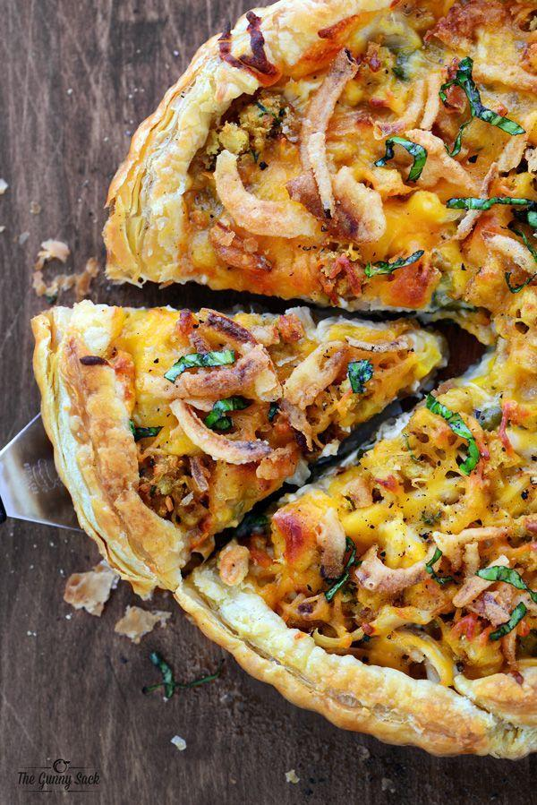 """<p>Using a puff pastry sheet, your Thanksgiving leftovers will transform into one of the best pizzas you've ever had. </p><p><strong>Get the recipe at <a href=""""http://www.thegunnysack.com/thanksgiving-pizza/"""" rel=""""nofollow noopener"""" target=""""_blank"""" data-ylk=""""slk:The Gunny Sack"""" class=""""link rapid-noclick-resp"""">The Gunny Sack</a>. </strong></p>"""