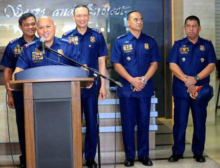 Philippine National Police (PNP) Chief Ronald dela Rosa with police Senior Superintendent Graciano Mijares (R), newly-appointed head of the PNP drug enforcement group, during the re-launch of police anti-narcotics operations at a news conference inside the police headquarters in Quezon city, metro Manila, Philippines March 6, 2017. REUTERS/Romeo Ranoco