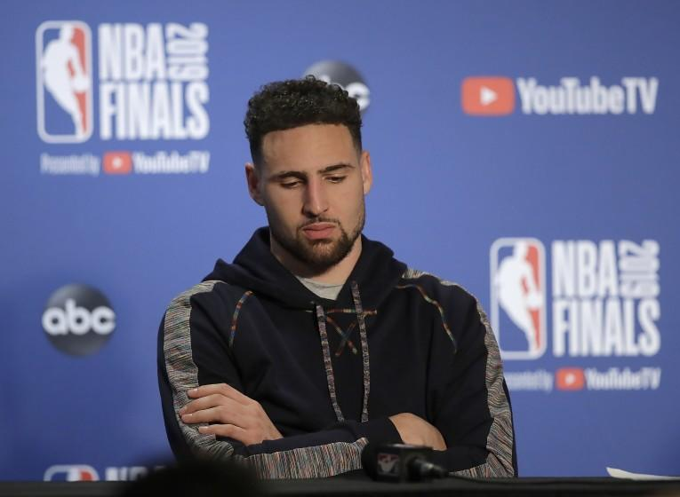 Golden State Warriors' Klay Thompson waits to speak during a media conference after Game 4 of basketball's NBA Finals against the Toronto Raptors Friday, June 7, 2019, in Oakland, Calif. (AP Photo/Ben Margot)