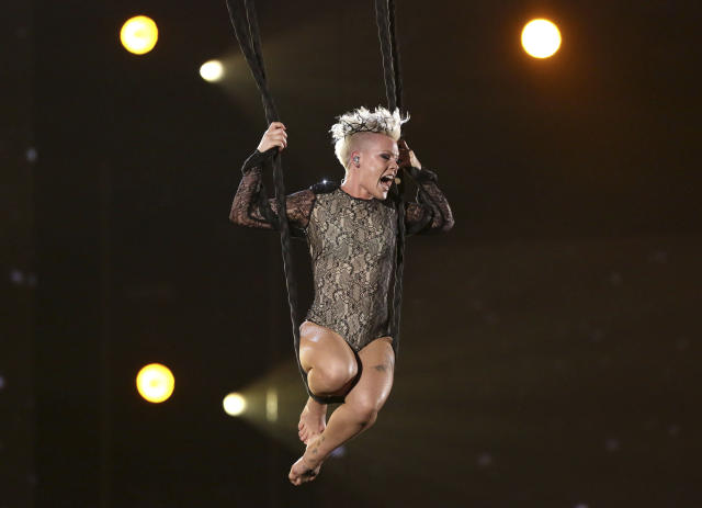 "Pink performs ""Just Give Me a Reason"" at the 56th annual Grammy Awards in 2014. She'll sing the national anthem at Super Bowl LII. (AP)"