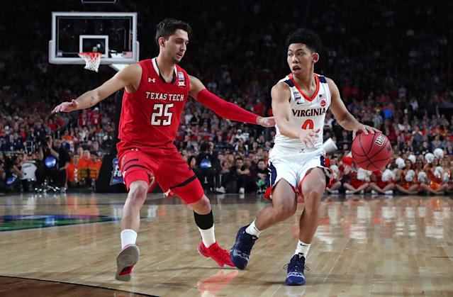 Kihei Clark #0 of the Virginia Cavaliers is defended by Davide Moretti #25 of the Texas Tech Red Raiders in the first half during the 2019 NCAA men's Final Four National Championship game at U.S. Bank Stadium on April 08, 2019 in Minneapolis, Minnesota. (Photo by Tom Pennington/Getty Images)