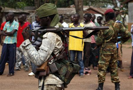 A Chad soldier holds his weapon in Bangui December 9, 2013. REUTERS/Emmanuel Braun