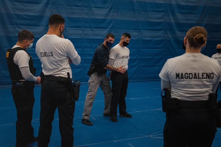 "Instructor Javier Sola teaches frisking and handcuffing methods to future law enforcement officers at the state-run training facility in Washington state.<span class=""copyright"">Jovelle Tamayo for TIME</span>"