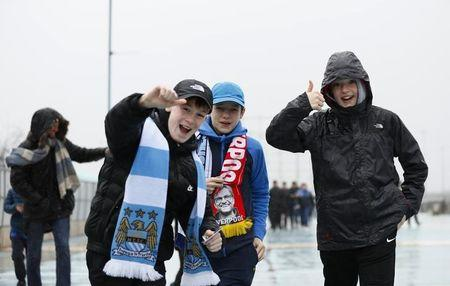 Britain Soccer Football - Manchester City v Liverpool - Premier League - Etihad Stadium - 19/3/17 Young fans pose outside the ground before the match  Action Images via Reuters / Jason Cairnduff Livepic