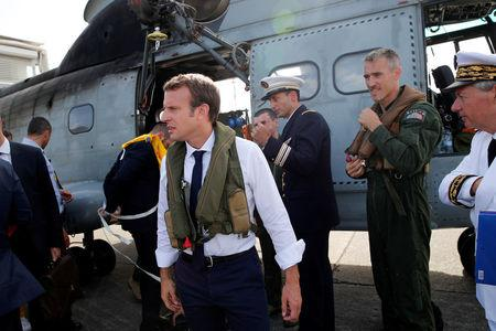 France's President Emmanuel Macron waits on the tarmac of Pointe-a-Pitre airport, Guadeloupe island, before boarding an helicopter en route to French Caribbean islands of St. Martin and St. Barthelemy,  September 12, 2017. REUTERS/Christophe Ena/Pool