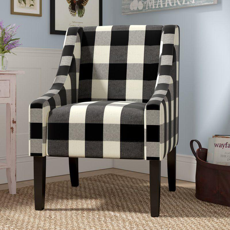 """<p><strong>Laurel Foundry Modern Farmhouse</strong></p><p>wayfair.com</p><p><a href=""""https://go.redirectingat.com?id=74968X1596630&url=https%3A%2F%2Fwww.wayfair.com%2Ffurniture%2Fpdp%2Fgullo-armchair-lfmf3074.html&sref=https%3A%2F%2Fwww.countryliving.com%2Fhome-design%2Fg31785674%2Ftop-cozy-chairs%2F"""" rel=""""nofollow noopener"""" target=""""_blank"""" data-ylk=""""slk:CHECK PRICE"""" class=""""link rapid-noclick-resp"""">CHECK PRICE</a></p><p>This black-and-white plaid chair adds interest and warmth to any space—and goes with just about any color palette.</p>"""