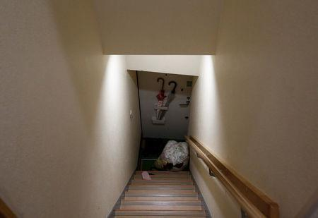 A sack containing laundries is placed on a stair at an apartment which is used as Airbnb service after customers checked out in Tokyo, Japan March 12, 2018. REUTERS/Kim Kyung-Hoon