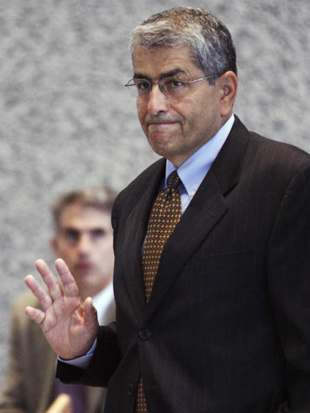 Ali Ata, the former director of the Illinois Finance Authority, waves as he leaves federal court in Chicago, Tuesday, July 17, 2012, after being sentenced to four years' probation for donating $50,000 to then-Illinois Gov. Rod Blagojevich's campaign in exchange for a state job. Ata's testimony at Blagojevich's first corruption trial helped convict the impeached governor on one count of lying to the FBI about fundraising. (AP Photo/M. Spencer Green)