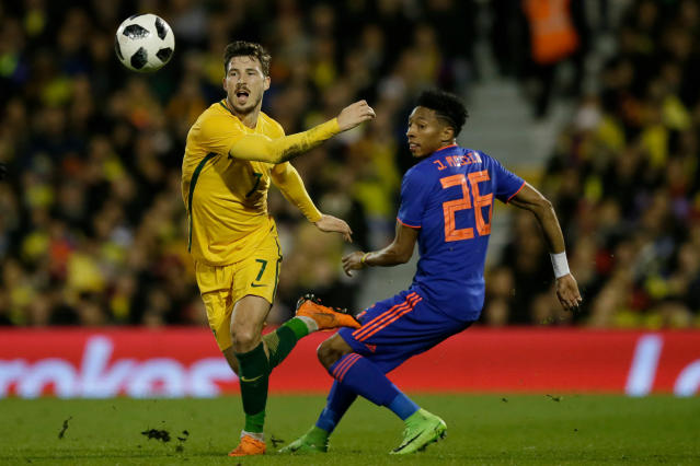 FILE - In this Tuesday, March 27, 2018 file photo, Australia's Mathew Leckie, left, and Colombia's Aleksandar Susnjar go for the ball during a friendly soccer match between Colombia and Australia in London. (AP Photo/Tim Ireland, File)