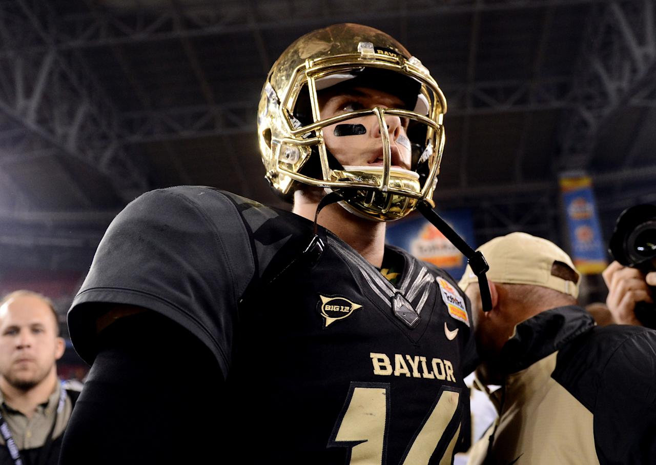 GLENDALE, AZ - JANUARY 01: Quarterback Bryce Petty #14 of the Baylor Bears walks off the field after losing to the UCF Knights 52-42 in the Tostitos Fiesta Bowl at University of Phoenix Stadium on January 1, 2014 in Glendale, Arizona. (Photo by Jennifer Stewart/Getty Images)