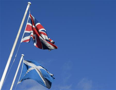 The Saltire and Union Flag fly together in a street before a debate in the Scottish Parliament on 'Scotland's future,' in Edinburgh