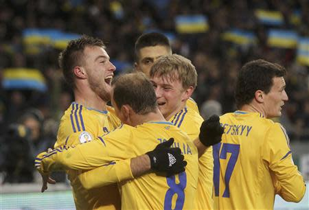 Ukraine's Andriy Yarmolenko (L) celebrates his goal with team mates during their 2014 World Cup qualifying first leg playoff soccer match against France at the Olympic stadium in Kiev November 15, 2013. REUTERS/Valentyn Ogirenko