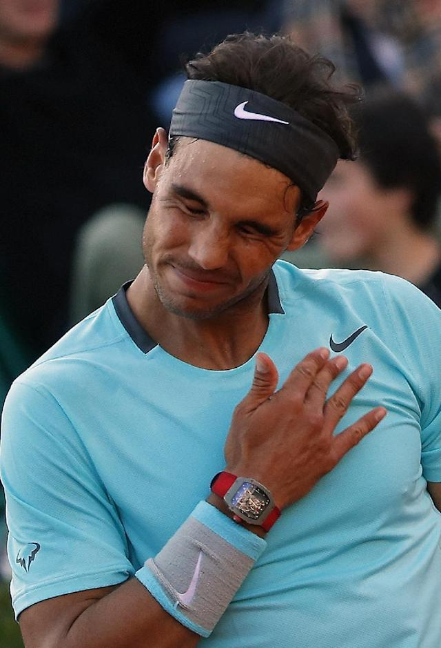 Spain's Rafael Nadal reacts as he plays compatriot David Ferrer during their quarterfinal match of the French Open tennis tournament at the Roland Garros stadium, in Paris, France, Wednesday, June 4, 2014. (AP Photo/Michel Euler)