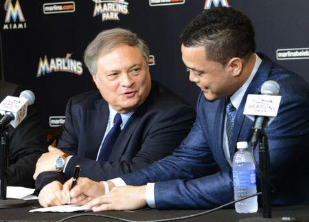 Marlins owner Jeffrey Loria (L) and Giancarlo Stanton, speak to the media at the Marlins Ballpark in Little Havana, Miami, Florida, November 19, 2014. REUTERS/Zachary Fagenson