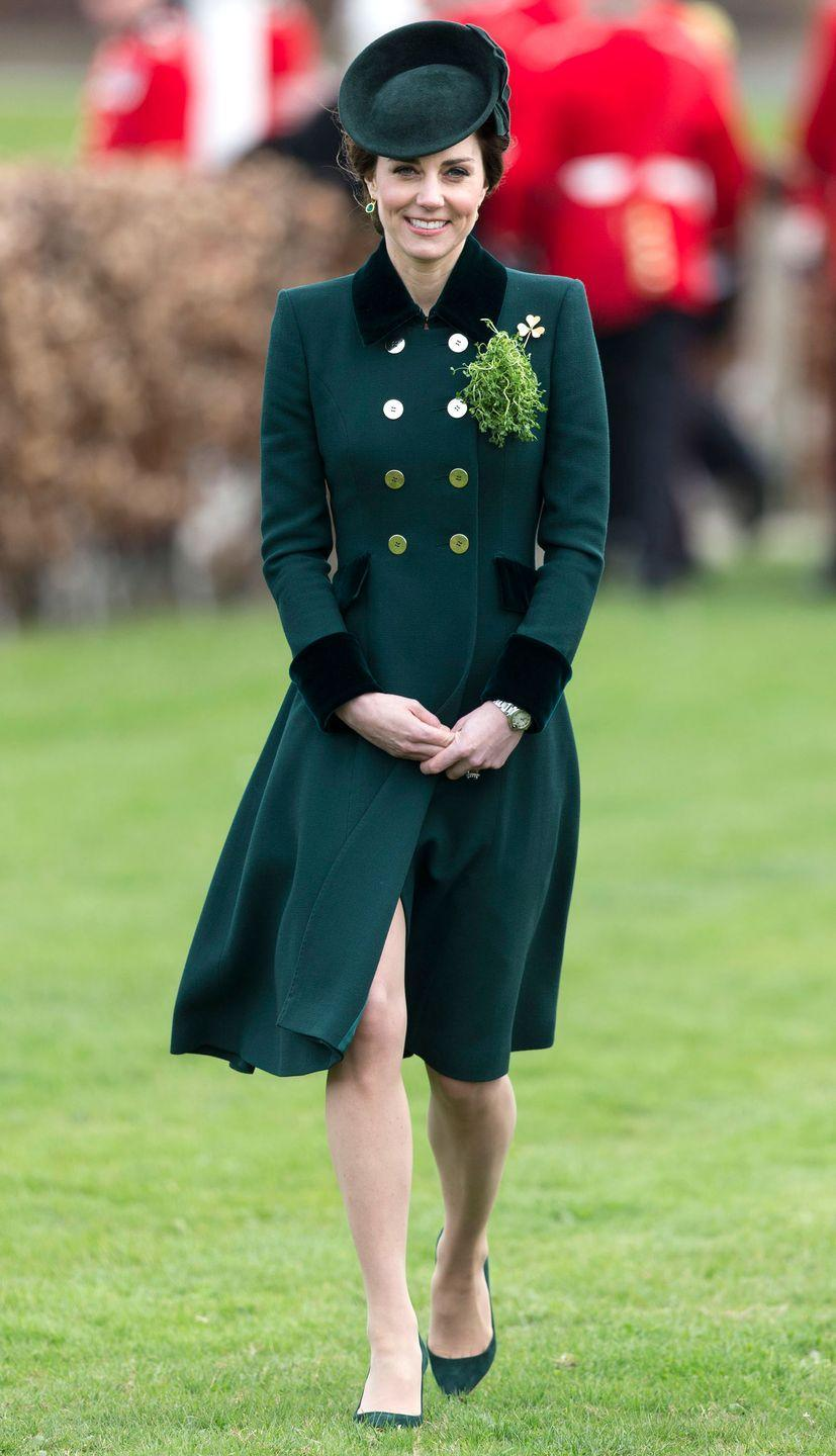 <p>In a forest green Catherine Walker coat dress, matching hat, Irish Guard brooch, Monica Vinader emerald earrings and suede Gianvito Rossi pumps at the St. Patrick's Day parade in London.</p>