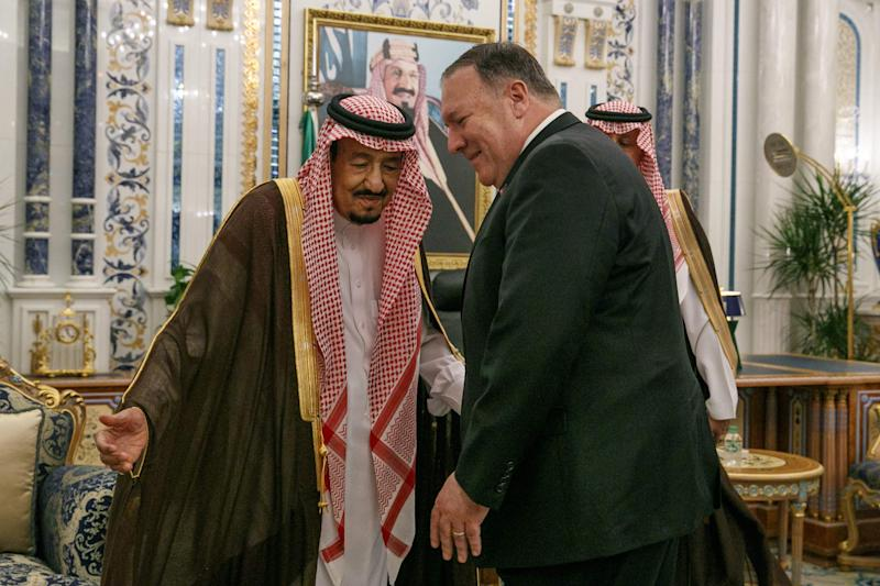 """US Secretary of State Mike Pompeo (R) is received by Saudi King Salman bin Abdulaziz at Al Salam Palace in the Red Sea city of Jeddah on June 24, 2019. - Pompeo traveled to meet with Saudi leaders today to build a """"global coalition"""" against the Islamic Republic of Iran."""