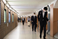 People wearing face masks walk through an underpass tunnel in Tokyo on Thursday, May 13, 2021. The Japanese capital confirmed more than 1,000 new coronavirus cases on Thursday. (AP Photo/Hiro Komae)