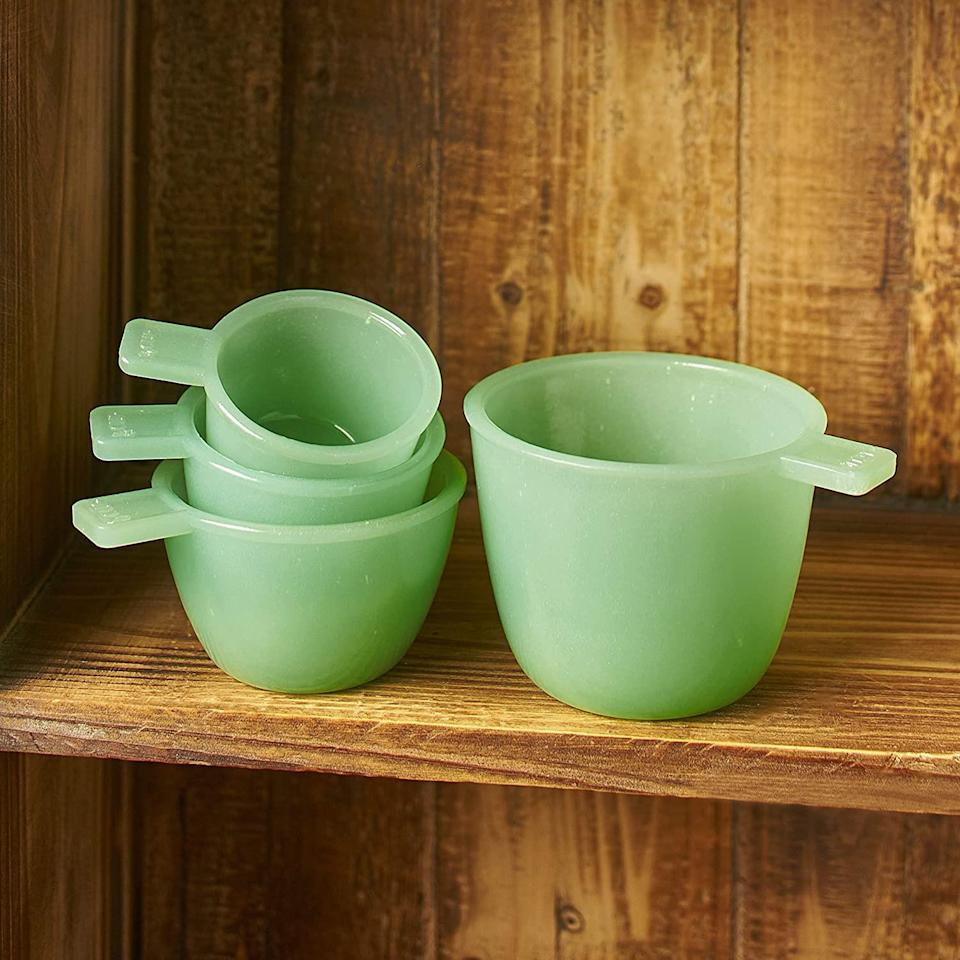 """<p>These measuring cups are like an extra dose of sugar for your baking cabinet. If you've been looking for more inspiration to bake, this set of four might be the ticket.</p> <p><strong>Buy It: $16.50; <a href=""""https://www.amazon.com/Jade-Green-Glass-Measuring-Cups/dp/B07ZJTXBZX/ref=as_li_ss_tl?ie=UTF8&linkCode=ll1&tag=slhomejadeitekitchentrendkyarborough0820-20&linkId=7b2d31266475cf63042ffe0800aa0584&language=en_US"""" rel=""""nofollow noopener"""" target=""""_blank"""" data-ylk=""""slk:amazon.com"""" class=""""link rapid-noclick-resp"""">amazon.com</a></strong></p>"""