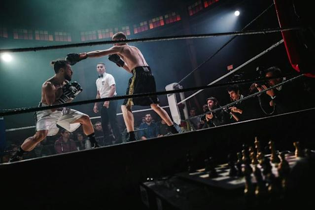 France's first competitive bout of chessboxing drew an enthralled crowd to Paris's Cabaret Sauvage (AFP Photo/LUCAS BARIOULET)