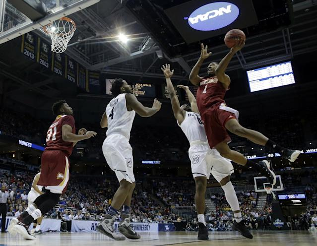 <p>Winthrop's Roderick Perkins (1) goes up for a shot against Butler's Avery Woodson (0) during the second half of an NCAA college basketball tournament first round game Thursday, March 16, 2017, in Milwaukee. (AP Photo/Morry Gash) </p>