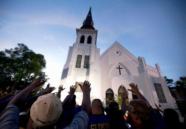 PHOTO: The men of Omega Psi Phi Fraternity Inc. lead a crowd of people in prayer outside the Emanuel AME Church, after a memorial for the nine people killed by Dylann Roof in Charleston, S.C., June 19, 2015. (Stephen B. Morton/AP, FILE)