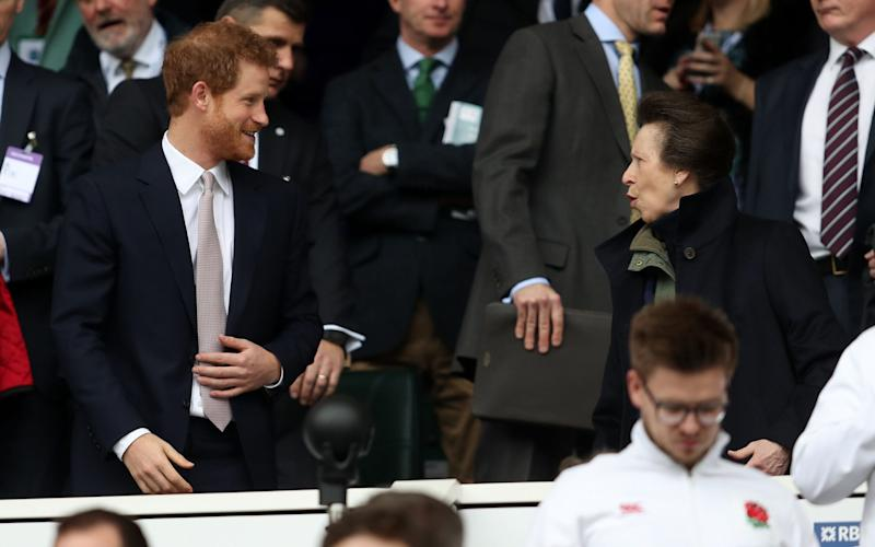 Prince Harry talks to the Princess Royal in the stands at Twickenham today - Credit: David Davies/PA