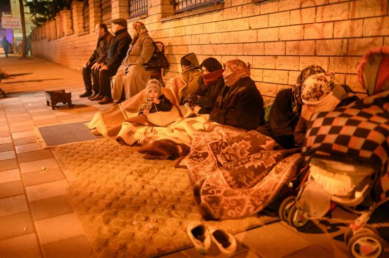 Many residents preferred to spend another night outside despite the cold (AFP Photo/BULENT KILIC)