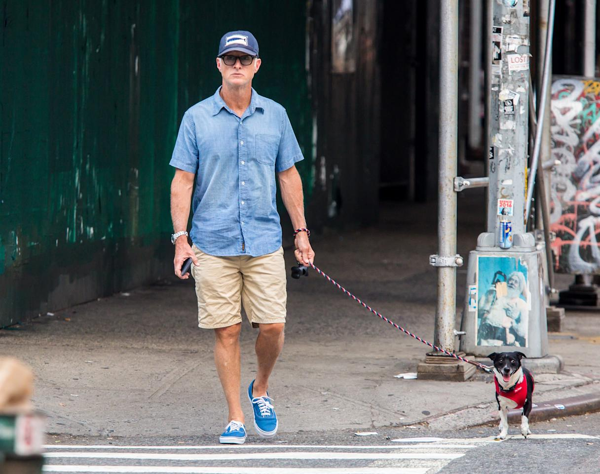 <p>John Slattery's chino shorts and bright blue add-ons is dog-walking style, done right.</p>