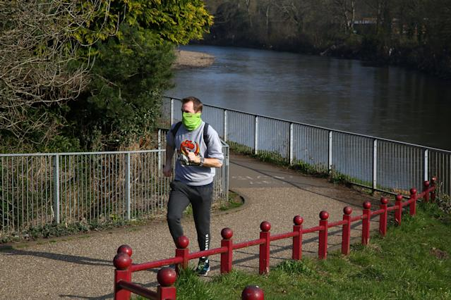 A jogger exercises in a park in Cardiff. (Getty Images)