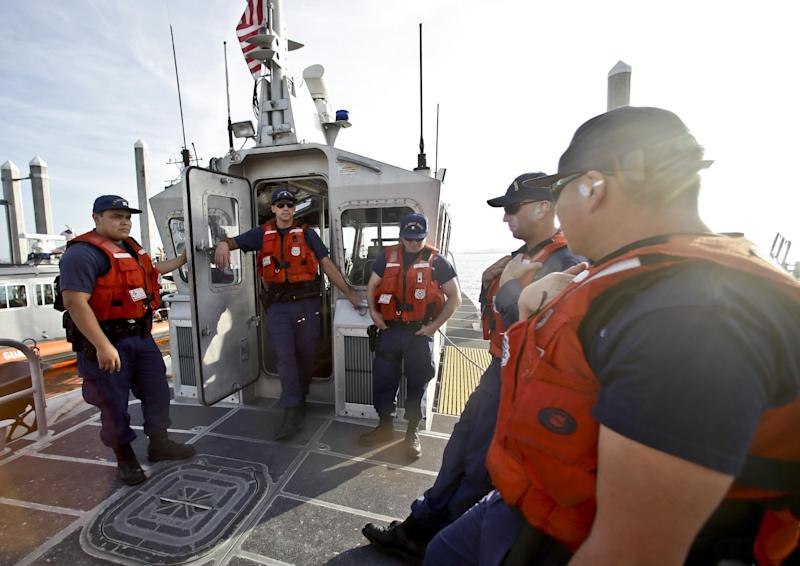 This photo taken Jan. 28, 2014, shows the crew of a 45 foot Coast Guard patrol boat runs through their pre-departure briefing in San Diego harbor in San Diego. Once the vessel exited the harbor area it encountered a dense fog. With the drug war locking down land routes across Latin America and at the U.S. border, smugglers have been increasingly using large vessels to carry multi-ton loads of cocaine and marijuana hundreds of miles offshore where the lead federal agency with extensive law enforcement powers is the Coast Guard, a military service roughly the size of the New York Police Department. (AP Photo/Lenny Ignelzi)