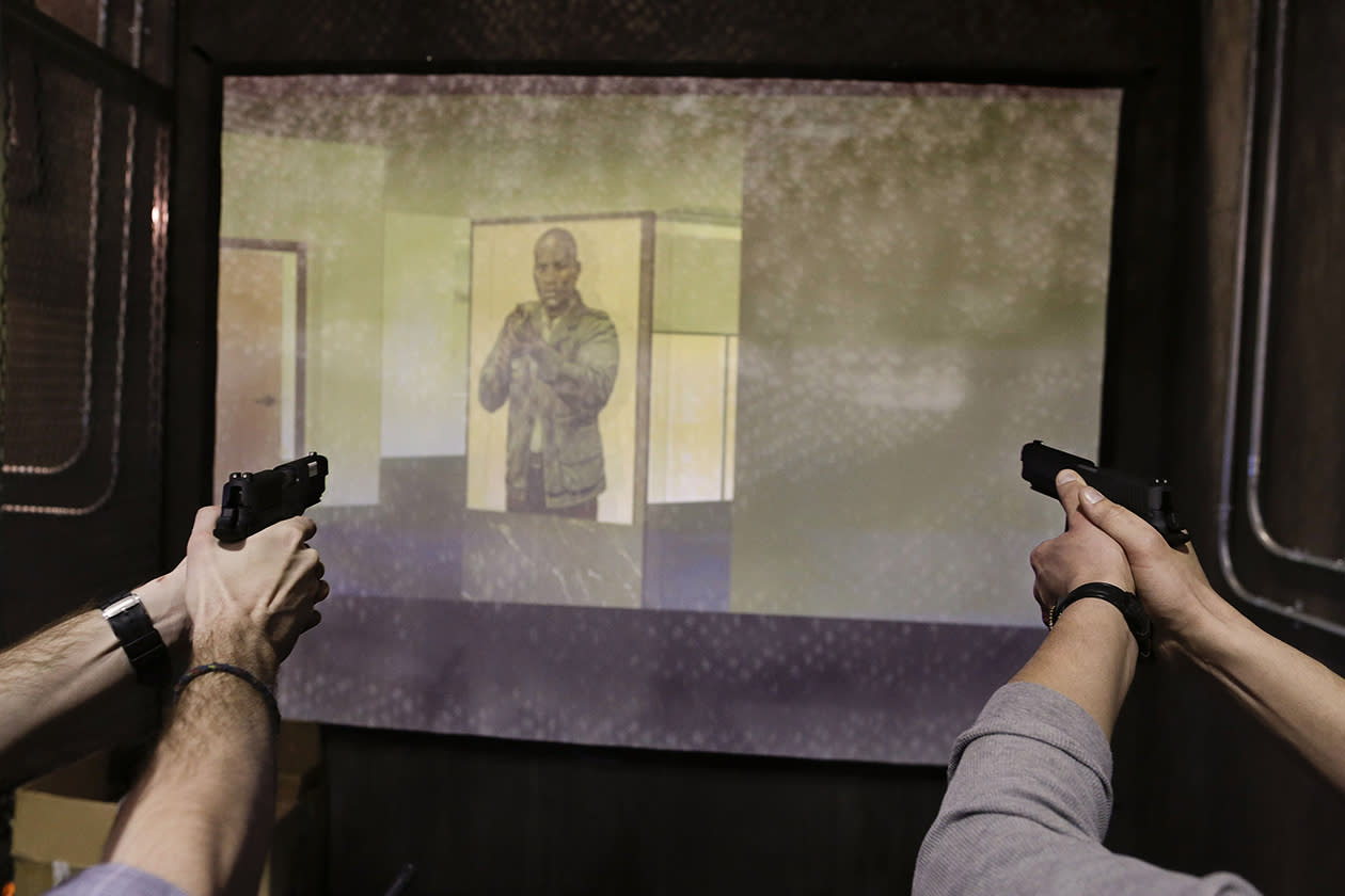 Convention attendees try out a Ti Training Lab Use of Force Simulator.
