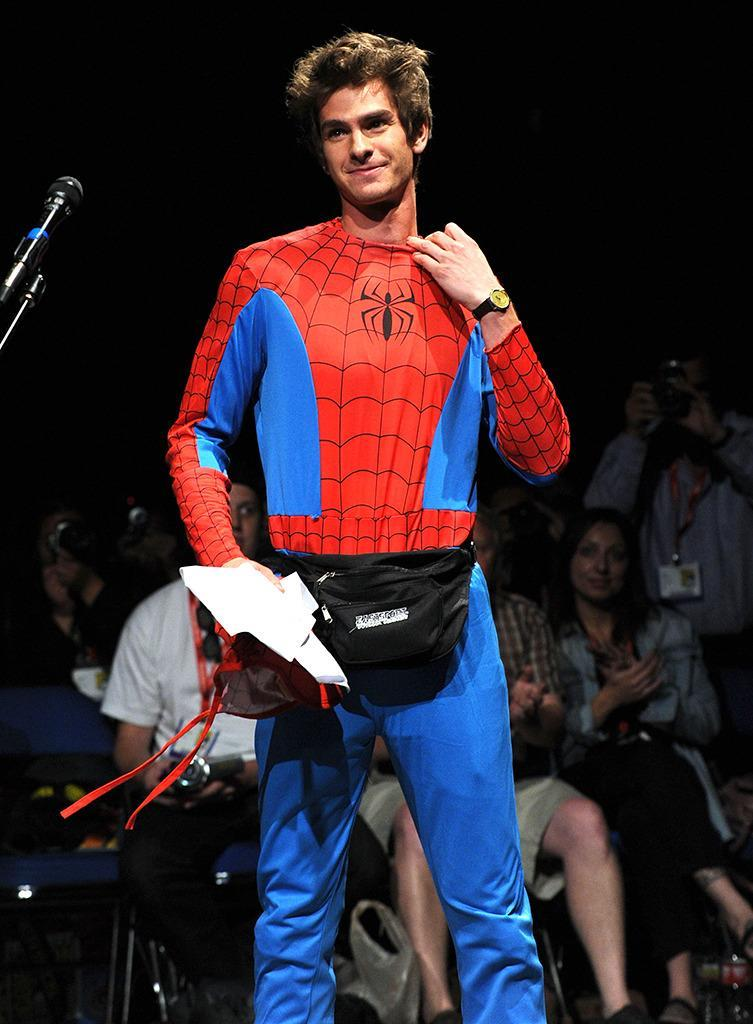 """<p>Garfield started off the 2011 <i>The Amazing Spider-Man </i>panel <a href=""""https://www.yahoo.com/movies/bp/comic-con-2011-amazing-spider-man-panel-highlights-162419307.html"""" data-ylk=""""slk:pretending to be a fan asking a question;outcm:mb_qualified_link;_E:mb_qualified_link;ct:story;"""" class=""""link rapid-noclick-resp yahoo-link"""">pretending to be a fan asking a question</a> before taking off his mask to reveal his true identity. <i>(Photo: Kevin Winter/Getty Images)</i></p>"""