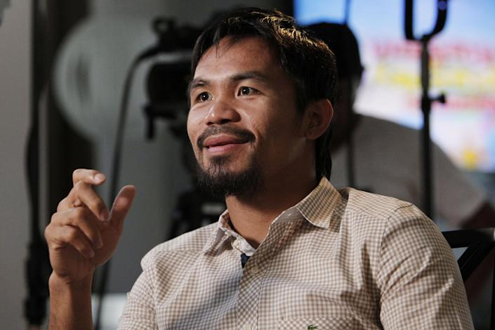 """Boxer and politician Manny Pacquiao speaks about his views on same-sex marriage, and other subjects, during the taping of a television segment for the show """"Extra"""" at his home in Los Angeles, Wednesday, May 16, 2012. Pacquiao was quoted in a recent interview as opposing President Barack Obama's views on same-sex marriage. (AP Photo/Reed Saxon)"""