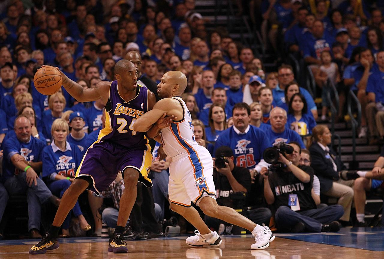 OKLAHOMA CITY, OK - MAY 21:  Kobe Bryant #24 of the Los Angeles Lakers dribbles the ball against Derek Fisher #37 of the Oklahoma City Thunder during Game Five of the Western Conference Semifinals of the 2012 NBA Playoffs at Chesapeake Energy Arena on May 21, 2012 in Oklahoma City, Oklahoma.  NOTE TO USER: User expressly acknowledges and agrees that, by downloading and or using this photograph, User is consenting to the terms and conditions of the Getty Images License Agreement.  (Photo by Ronald Martinez/Getty Images)
