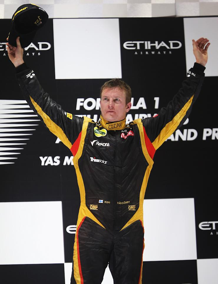 ABU DHABI, UNITED ARAB EMIRATES - NOVEMBER 04:  Kimi Raikkonen of Finland and Lotus celebrates on the podium after winning the Abu Dhabi Formula One Grand Prix at the Yas Marina Circuit on November 4, 2012 in Abu Dhabi, United Arab Emirates.  (Photo by Mark Thompson/Getty Images)
