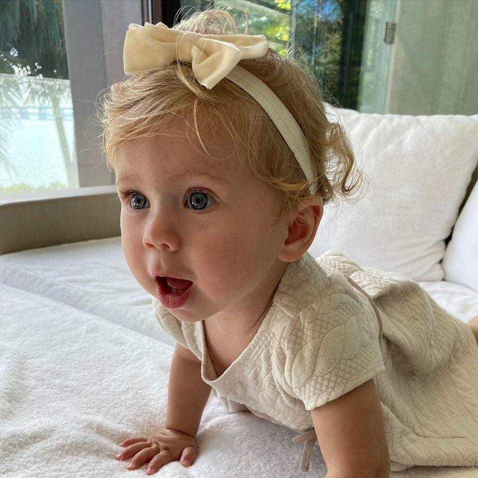 """<p>Mary <a href=""""https://people.com/parents/anna-kournikova-daughter-mary-turns-1-sweet-photo/"""" rel=""""nofollow noopener"""" target=""""_blank"""" data-ylk=""""slk:turned 1 on Jan. 30, 2021"""" class=""""link rapid-noclick-resp"""">turned 1 on Jan. 30, 2021</a>, and <a href=""""https://www.instagram.com/p/CKrkbQ3Bfdb/"""" rel=""""nofollow noopener"""" target=""""_blank"""" data-ylk=""""slk:looked picture-perfect"""" class=""""link rapid-noclick-resp"""">looked picture-perfect</a> in her neutral ensemble and matching bow. </p>"""