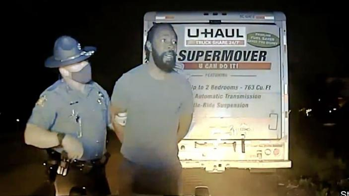 Marion Humphrey Jr, a law student at University of Arkansas, is seen handcuffed and held by a state trooper in a police dash cam video.