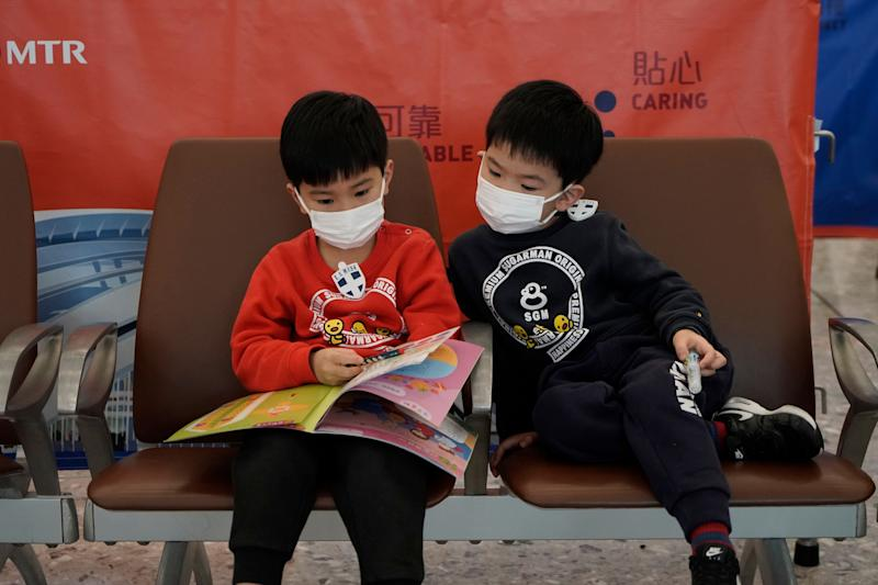<strong>Passengers wear masks to prevent an outbreak of a new coronavirus in the high speed train station, in Hong Kong, Wednesday.</strong> (Photo: ASSOCIATED PRESS)